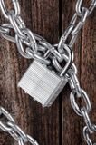 Closed lock with a chain Royalty Free Stock Image