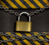 Closed lock with chains and metal background Royalty Free Stock Photo