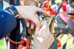 Closed lock and key thrown away - the key to a long and happy married life Stock Photo