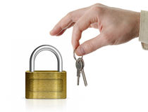 Closed lock with man's hand and keys Royalty Free Stock Image