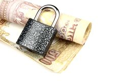 Closed Lock on a rolled 500 rupee note Royalty Free Stock Images