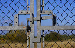 Closed and locked gates. With blue sky stock images
