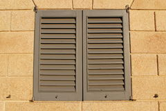 Closed louver window. Closed shutter in a louver window Stock Photos