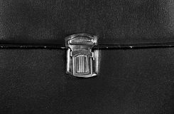 Closed metal buckle on textured black leather of vintage case cl Royalty Free Stock Photography