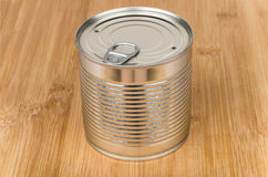 Closed metal cans with ring on bamboo board Stock Photo