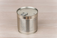 Closed metal cans with ring on table Stock Image