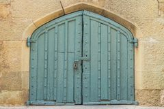 Closed door in the ancient fortress. Closed metal door in the ancient fortress royalty free stock photos