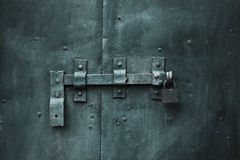 Closed metal door with lock royalty free stock image