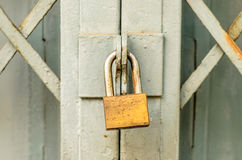 Closed metal door with lock Royalty Free Stock Photos