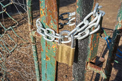 Closed metal door with padlock and chain Stock Images