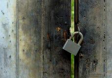 Closed metal lock wooden door Stock Photo