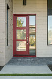 Closed modern red exterior door of a home royalty free stock photos