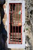 Closed. Morbid red metal door, stairs behind Royalty Free Stock Image