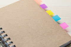 Closed notebook with colourful sticker note Stock Photo