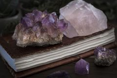 Closed Notebook or Journal with Amethyst and Rose Quartz Crystals on top