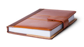 Closed notebook in leather cover Royalty Free Stock Photos