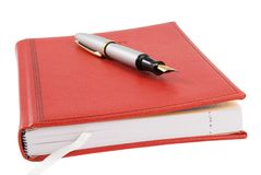 Closed notebook and pen Royalty Free Stock Images