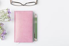 Closed notebook with pen Stock Photos