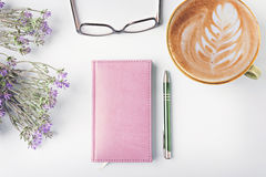 Closed notebook with pen Stock Images