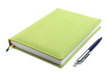 Closed notebook and pen Royalty Free Stock Photos