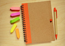 Closed notebook, pen and stickers Royalty Free Stock Photo