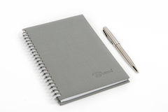 Closed notebook with pen. On white background Stock Images