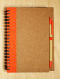 Closed notebook with a pen Royalty Free Stock Photography