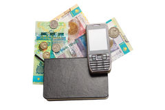 Closed notebook and some money of kazakhstan over Royalty Free Stock Photo