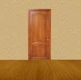 The closed oak door. Is in an empty room Royalty Free Stock Image