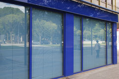 Closed office in the street. In blue tones Stock Photos