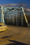 Closed Old Blue Metal Truss Bridge on Sunny Winter Afternoon Royalty Free Stock Photography