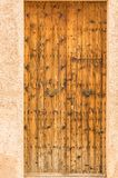 Rustic wooden front door of mediterranean house Royalty Free Stock Photography