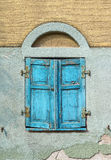 Closed old light blue window shutter Royalty Free Stock Photography