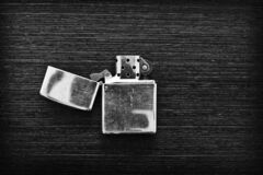 Free Closed Old Lighter On Wooden Table Royalty Free Stock Images - 188956069