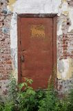 Closed old painted metal door, brown shabby paint stock images