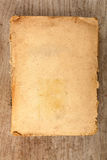 Closed old softcover book on a wooden background Stock Images