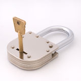 Closed old style padlock with key. Closed old style padlock isolated on white background Stock Image