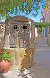 Closed old well in old Town, Spain Royalty Free Stock Images