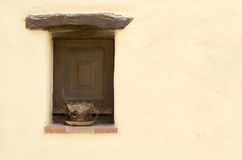 Closed old window. A minimalistic composition with an old closed wooden window Royalty Free Stock Image