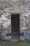 Old wooden door in brick wall Royalty Free Stock Images