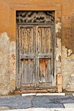 Closed Old Wooden Door. Decrepit, uninviting. No knocker or handle. The picture was taken in Rome, but it could be from anywhere. The door fairly screams, `Go Stock Photos