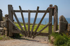 Old Wooden Gate. Closed old wooden gate above Druidstone Beach stock photo
