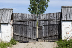 Closed old wooden gate in the countryside. Royalty Free Stock Photo