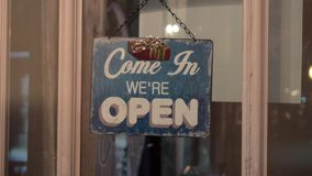 The closed and open sign on a glass door.. stock video