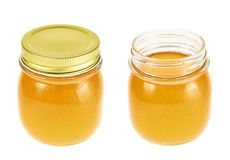 Closed and opened honey jar Royalty Free Stock Image