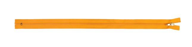 Closed orange zipper isolated over white background Royalty Free Stock Images