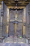 Closed ornate decorative brass door with locks Royalty Free Stock Images