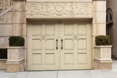Closed Ornate Swinging Beige Garage Doors of an Up Royalty Free Stock Image