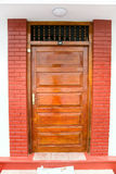 Closed ornate wood door of an upscale home, accented with an woo Royalty Free Stock Photo