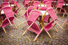 Closed outdoor cafe terrace with pink chairs Royalty Free Stock Image